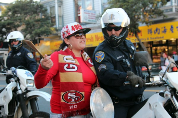 A fan talks to police on 23rd and Mission streets.