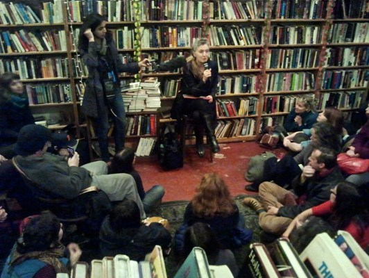 """Rebecca Solnit reads to an audience on the night of """"A Celebration of the Adobe Bookshop."""" Photo by Howard Gutstadt."""