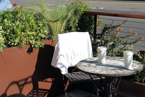 An empty chair at a parklet on Valencia Street.