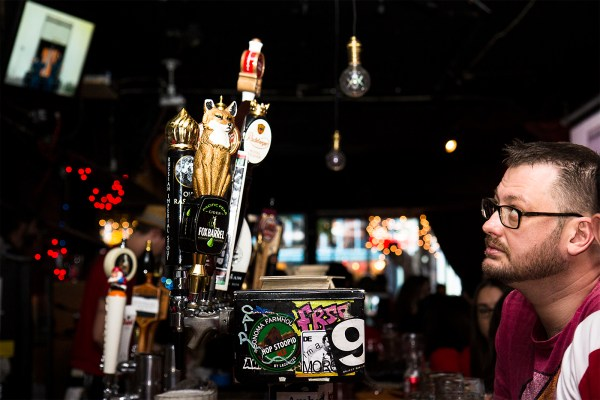 "A man watches the game at Delirium, where, according to bartender Mike Mutti, the day was ""a bit slow."" (Photo by Marta Franco)"
