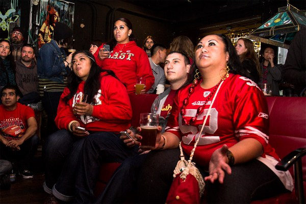 "Vernice Tafao and her friends watch the game at Gestalt. ""For me, this is not just a game,"" she said. ""It's tradition. It's like a treasure."" (Photo by Marta Franco)"