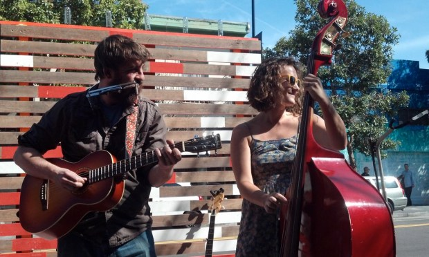 Musicians from the band The New Thoreaus play on the Street Stage in front of Dandelion Chocolate on Valencia Street.