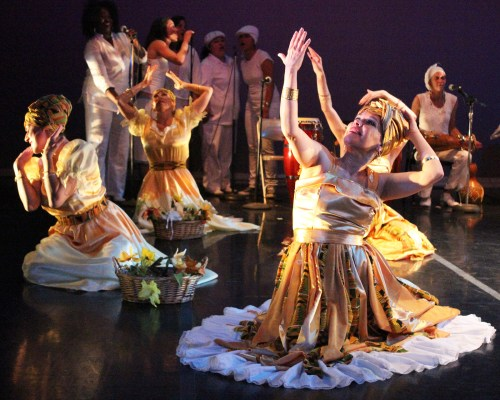 Dancers hypnotize the crowd in shimmering gold costumes. Photo by Erica Hellerstein.