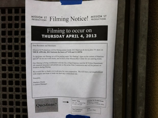 Filming notice posted along 21st and Harrison.