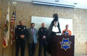 From left to right: Captain Robert Moser, Supervisor David Campos, Chief of Police Greg Suhr, Sister Pat N Leather at the podium, and Greg Carey of the Castro Community Patrol. Out of view is Supervisor Scott Wiener.