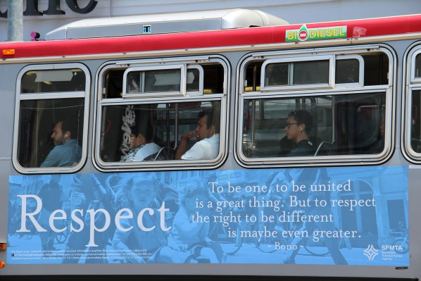 People ride a crowded bus down Mission Street on Tuesday afternoon.