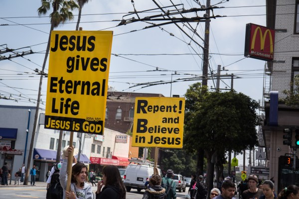 A religious group holds signs on Mission/16th.