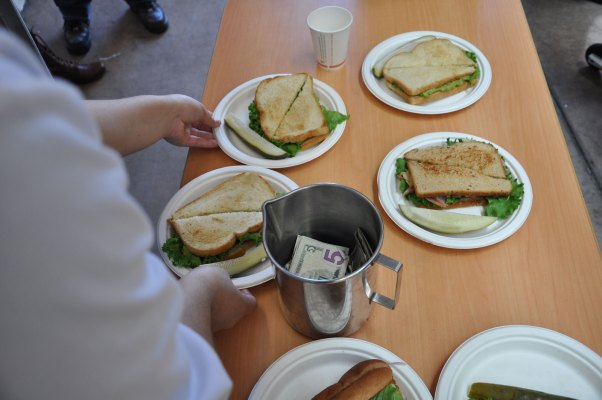 At the end of lunch, only a few sandwiches remained.