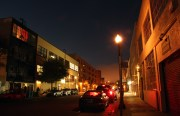 Capp Street between 16th and 17th, dark street with people and streetlamp