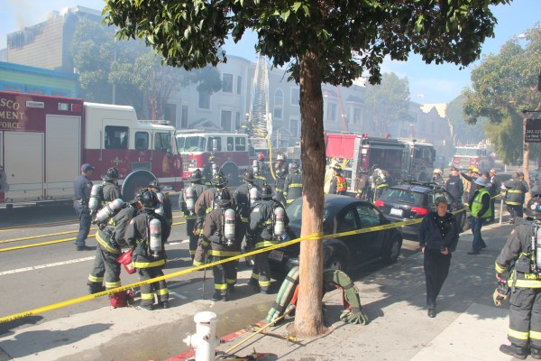 Approximately 100 firefighters worked to control the flames. Photo by Greta Mart.