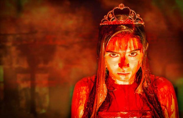 Cristina Ann Oeschger plays outcast Carrie White in the musical, Carrie. Image courtesy of Ray of Light.