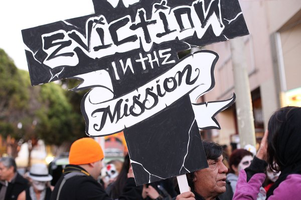 Artist Rene Yanez marches against evictions. Photo by Hélène Goupil