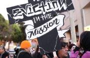 Artist Rene Yanez marches against evictions. Photo by Hélène Goupil