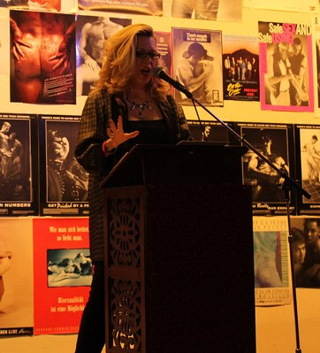 Shar Rednour reads during World AIDS Day. Photo By Heather Mack