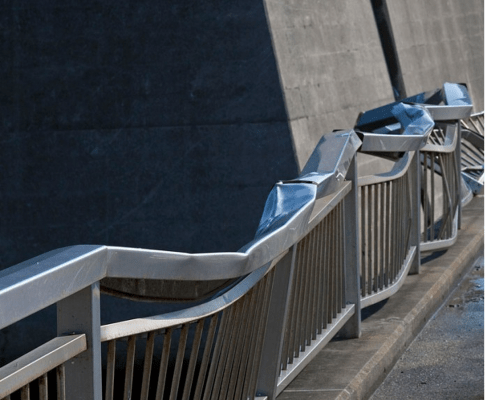 Stainless steel railings twisted by the force of the tidal wave.