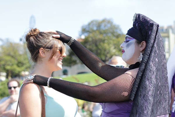 Sister Mary Magdalen, who is part of the Sisters of the Perpetual Indulgence, gives a blessing at Friday's Trans March. (Photo by Claudia Escobar)
