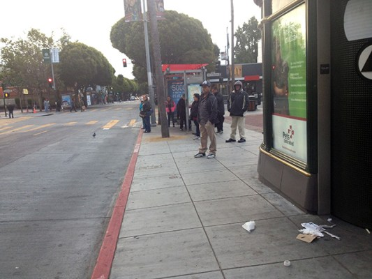 Riders at 6:30 a.m. catching one of the first buses of the day at 24th and Mission. Photo by