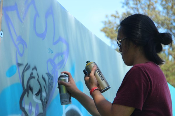 Dozens of artists painted at the Urban Youth Arts Festival at Precita Park on Saturday. Photo by Leslie Nguyen-Okwu.