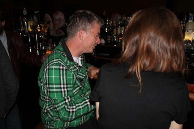 Tim League chats with Tiffany Schoepp, a Mission resident who wants to see the theater offer a wide range of cinematic experiences, at Mission Bar on Thursday night. Photo by Laura Wenus