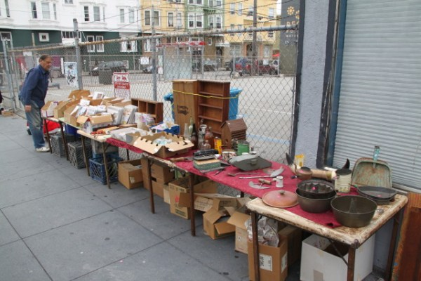 Various odds and ends being sold at the corner of 18th and Valencia. Photo by Joe Rivano Barros.