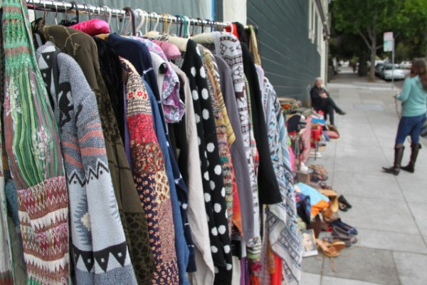 A number of street vendors come out on Sunday morning, this one selling mostly vintage clothing. Photo by Joe Rivano Barros.