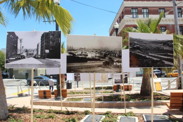 Historic images from 1866 to 1949 at the McCoppin Plaza's community exhibit featured the first Farmers Market on Duboce Avenue, an urban zoo on 14th and Valencia Streets, and the beginnings of the freeway system. Photo by Leslie Nguyen-Okwu.