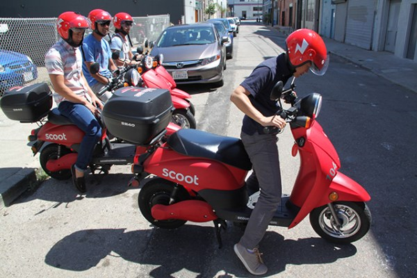 Scoots are heavier than they look and take some strategic pushing to get off the kickstand. Photo by Laura Wenus