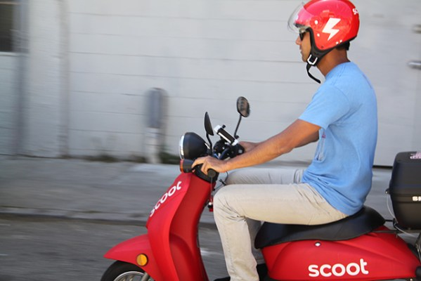 Matt Nish steers his Scoot down an alley during his first ride. Photo by Laura Wenus