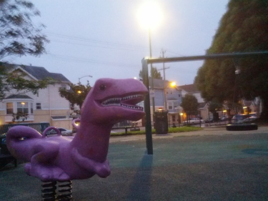 A lonely dinosaur in the playground at Garfield Square. Photo by Daniel Hirsch.