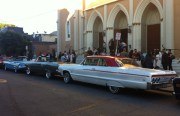 Frisco's Finest lowriders lined up outside St. Peter's church on 24th and Alabama Street. Photo by Andrea Valencia