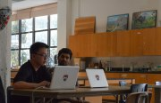 Justin Chen, left, discusses his college plans with Mission Bit volunteer Hurshal Patel.