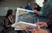 Liberty Hill Neighborhood Association members review a mural and rendering of what a Sutter affiliate health campus would look like at the ground floor of V20 on Valencia and 20th streets.