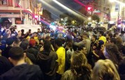 Scene at 16th and Valencia where some 100 people gathered at 9:30 p.m. Photo by Laura Wenus