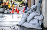 Sandbags line a wall after last year's flooding. Photo by Andrea Valencia