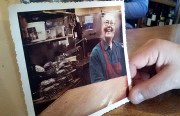 Awad Faddoul holds one of the few photos of Glenna Randolph, captured by a longtime customer and friend.