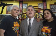 Carlos and Rubie Navarro, shown here with their lawyer Salvatore Timpano (center), are seeking financial assistance to afford their increased rent at Navarro's Martial Arts Academy & Gym.  Photo courtesy of Rubie Navarro.