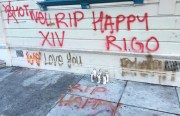 "A tag that reads ""RIP Happy"" and ""Rigo"" marks the spot near the intersection of 24th and Shotwell streets where the two men were gunned down just a few days apart. Photo By Laura Waxmann"