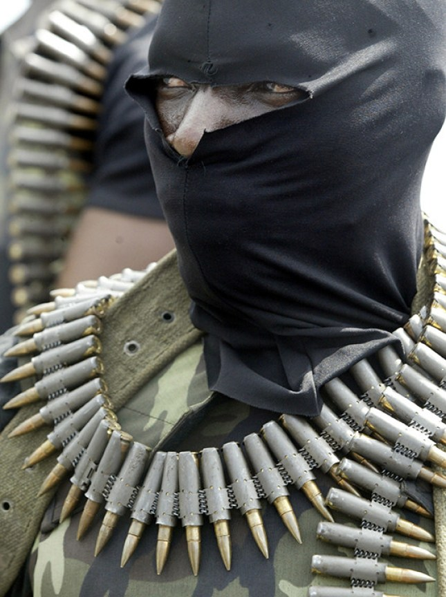 Militants wearing black masks, military fatigues and carrying Kalashnikov assault rifles and rocket-propelled grenade launchers patrol the creeks of the Niger Delta area of Nigeria, Friday, Feb. 24, 2006.Armed militants holding nine foreign oil workers hostage in Nigeria showed one of them to reporters for the first time Friday, a 68-year-old American who said he and his colleagues were being treated well. Three Americans, two Egyptians, two Thais, one Briton and one Filipino have been missing since they were kidnapped Feb. 18 by militants who stormed a barge belonging to a U.S. oil company in the Niger Delta's Forcados estuary. The kidnappers are demanding that people in the country's south receive a greater share of their region's oil wealth. ( Photo/George Osodi)