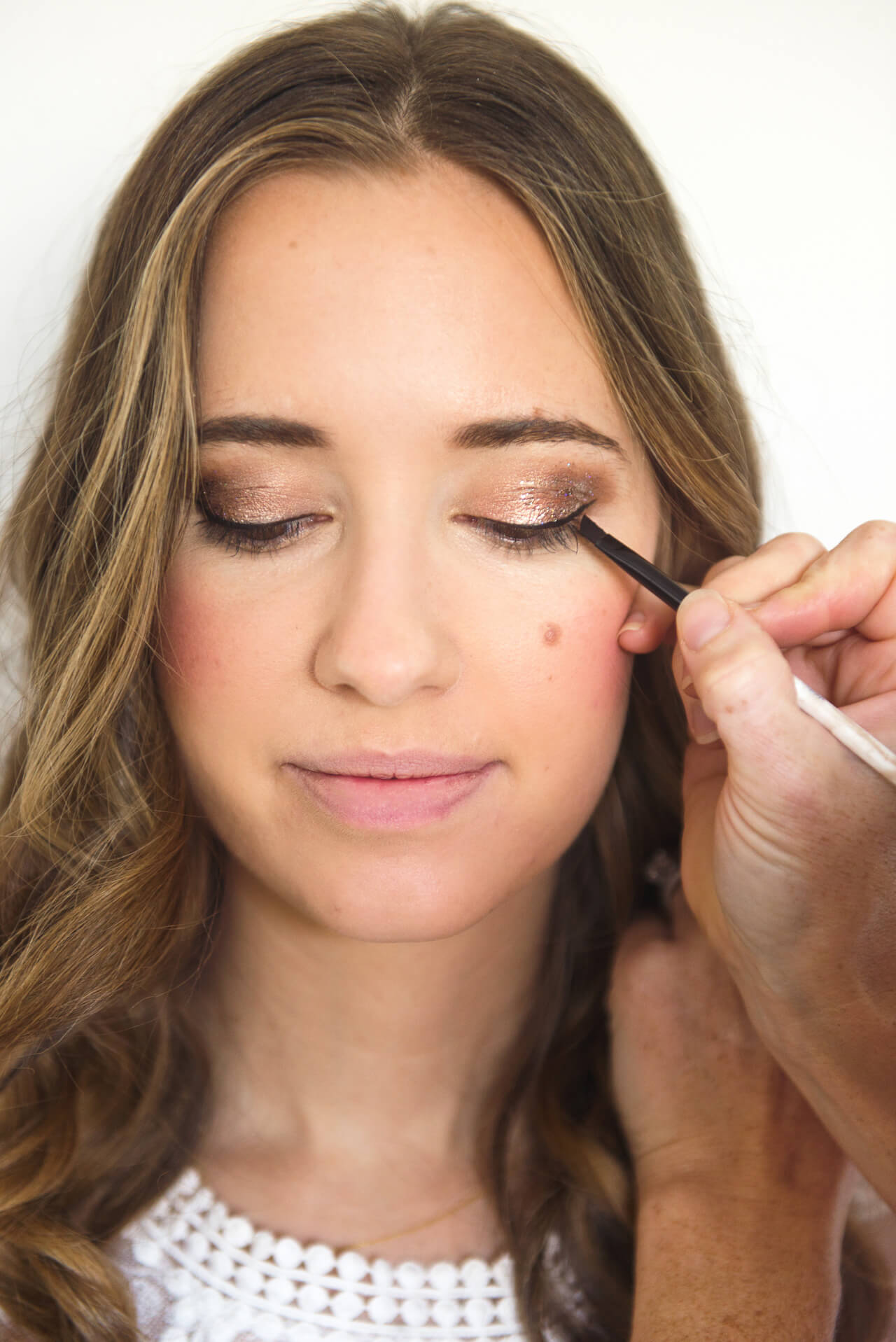 add black liquid liner to holiday makeup look