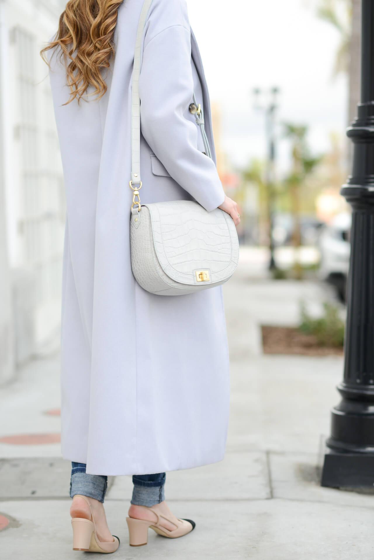long lavender winter coat with brahmin sonny bag