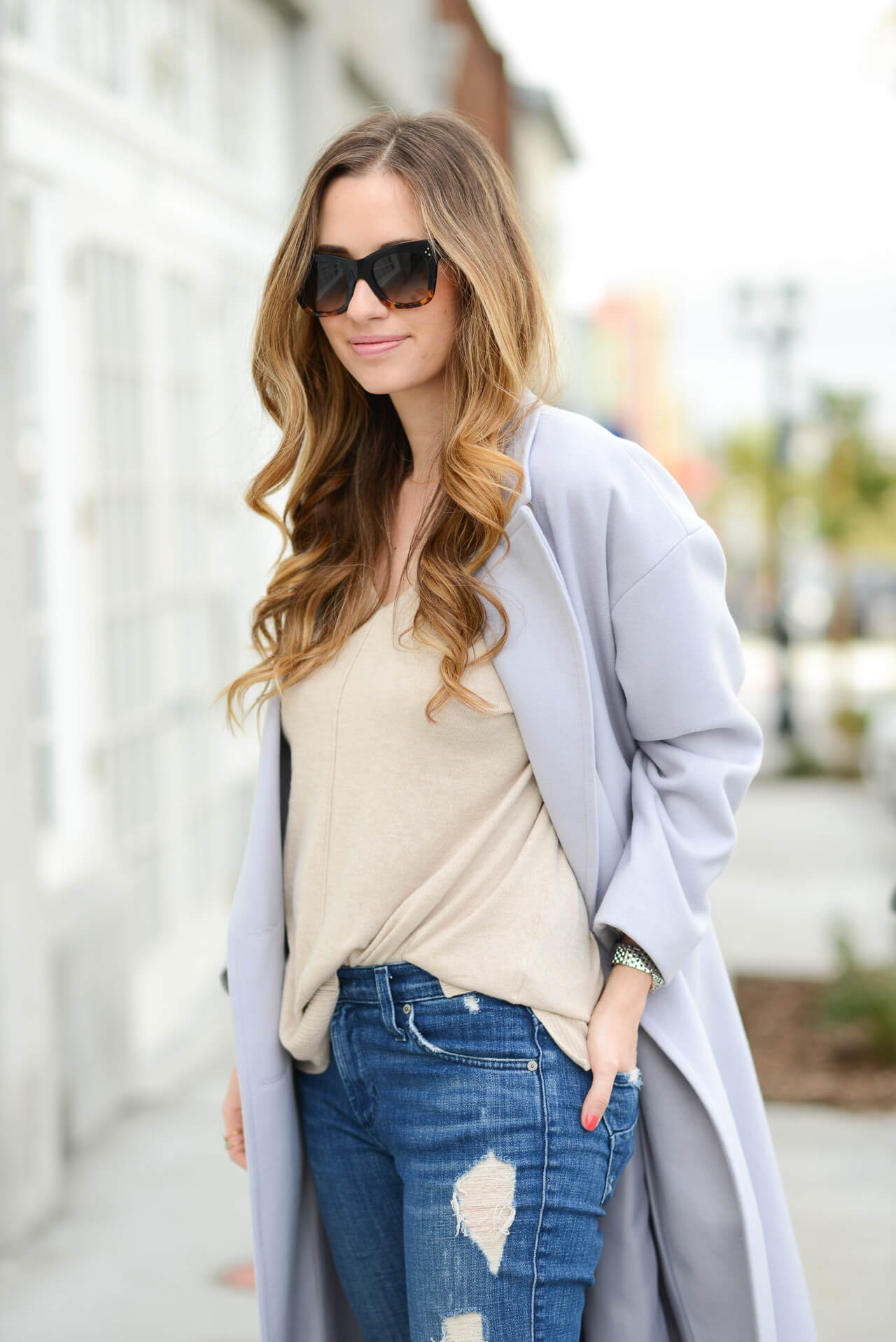tan sweater with distressed jeans
