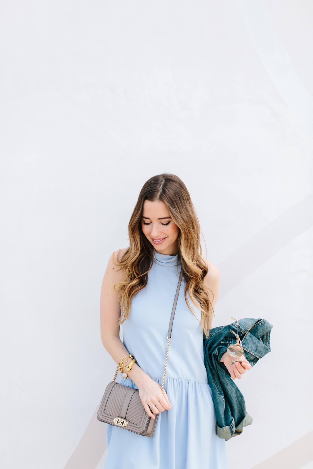 sleeveless blue dress with flowy hem