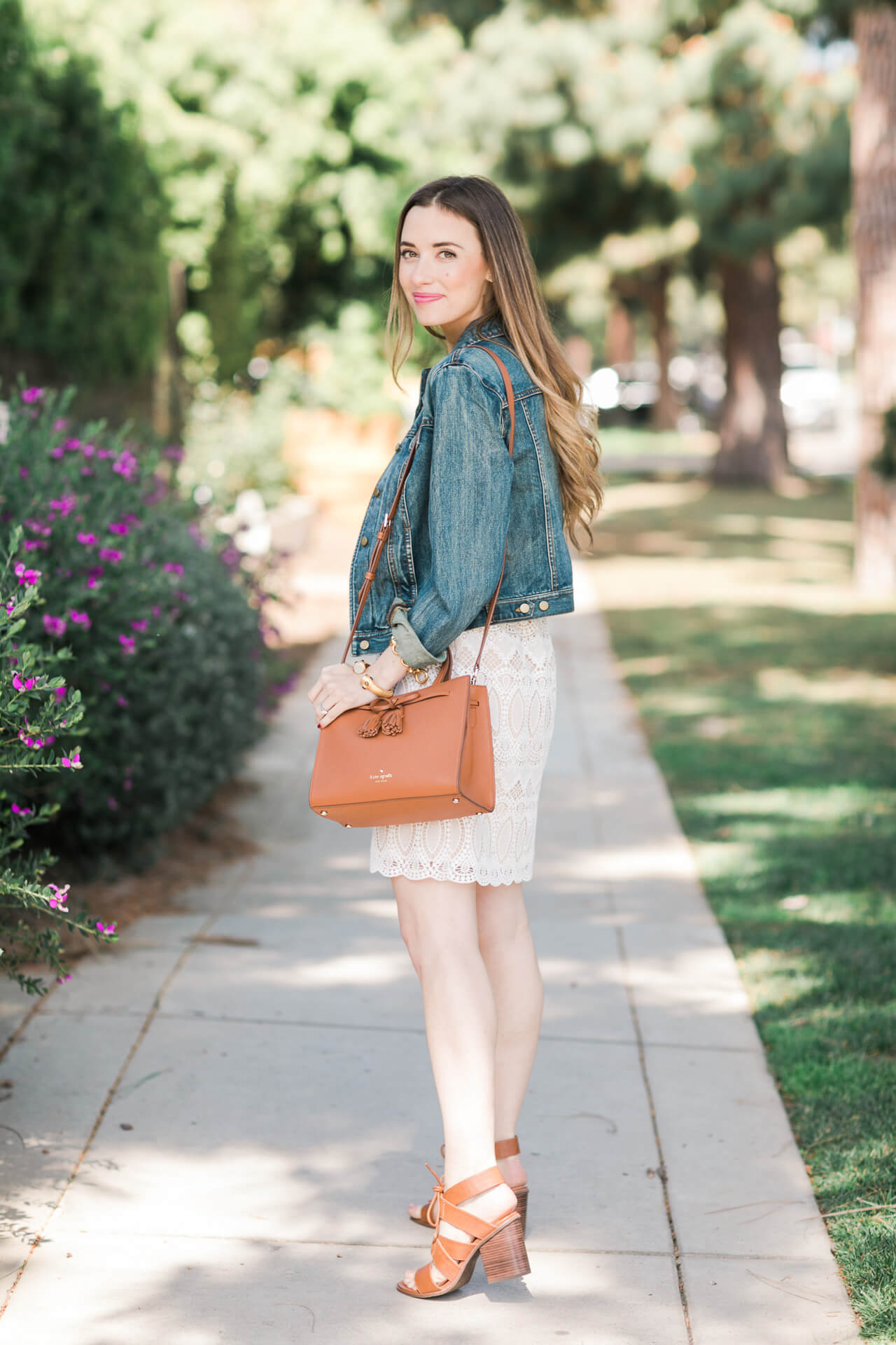 styling a denim jacket with a lace dress for spring