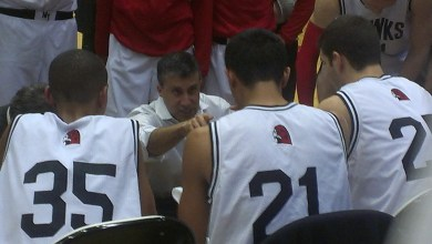 Hawks' Coach Nalin Sood talks to his team during a timeout.