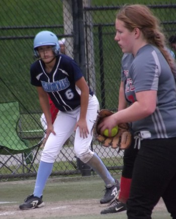 Terrace pitcher Ashley Fitzgerald is closely watched from third base by Meadowdale's Julia Reuble.