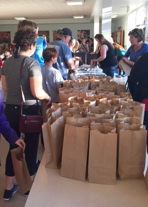 It was a full house at Edmonds Methodist Church Tuesday night as volunteers gathered for the Washington Kids in Transition's community packing party to benefit students in need. The bags will be distributed to the Edmonds School District's more than 600 homeless students through Washington Kids in Transition's after-school feeding program. (Photo by Jennifer Marx)