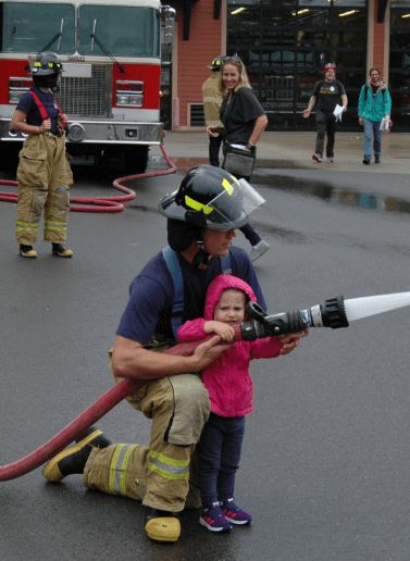 Fire District 1 held its Fire Safety Open House on Saturday near Martha Lake. Here, a child learns to operate a fire hose. (All photos courtesy Fire District 1)