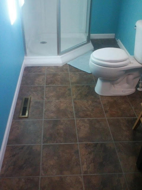 The corner shower opens a lot of room up in this small for Home bathroom remodel