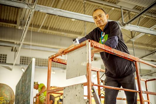 Carlos Salas during exhibit installation