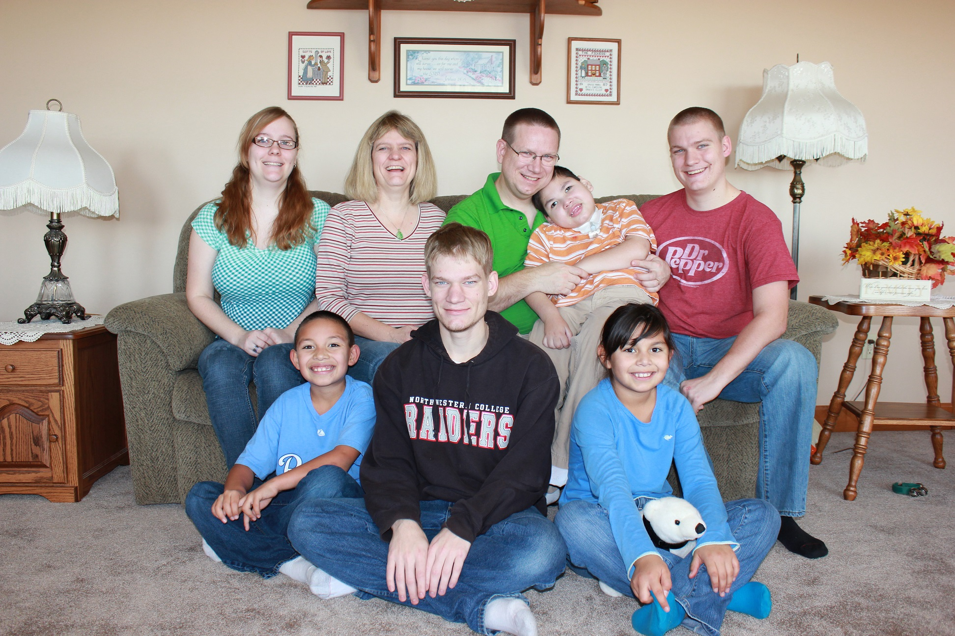 Photo: A Family of eight pose in their living room for a photo